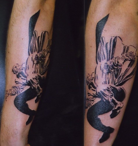 a tattoo of marv from sin city graphic novels done by russell at bizarre ink