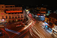 Anarchy!..in the streets of Hanoi (DarioM_72) Tags: street city longexposure travel people building car night lights asia southeastasia traffic bikes vietnam hanoi dariomilano
