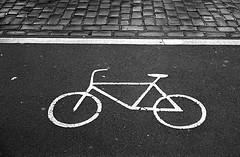 cycle lane (ciaron) Tags: road street blackandwhite berlin film wet path cycle lane cobbles canonet ql17 adox chm400 aculux