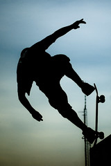 Skater Silhouette (Christopher Wallace) Tags: skater trick charlotte speedweek race halfpipe sillhouette action sports skateboard dramatic nikon d70s northcarolina nc tryonstreet 18200mm vr sky outdoor