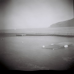 Pissouri Bay, Cyprus (kevin dooley) Tags: sea bw favorite white black 120 6x6 film water beautiful analog wow bay interesting fantastic lomo lomography flickr pretty mediterranean very good gorgeous awesome large cyprus award superior super best most negative diana winner stunning excellent medium format much incredible vignetting breathtaking exciting phenomenal pissouri noprocessing dianaplus