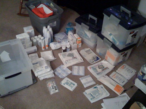 photo of boxes with nursing gear in them and wound care gear laid out on floor