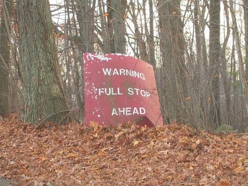 Unusual stop ahead sign