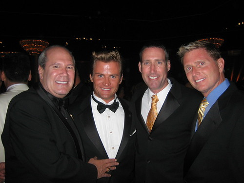 Ron Palmieri, far left, Charles Robbins, executive director of The Trevor Project, far right.