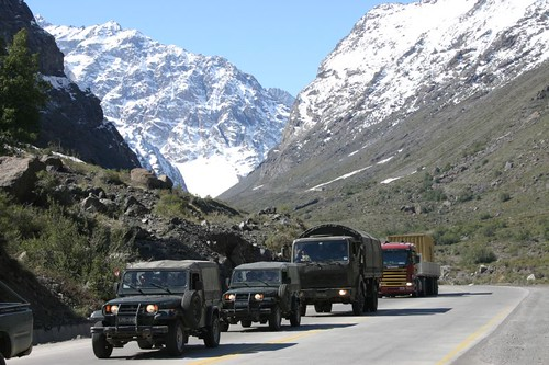 Army vehicles, near Rio Blanco, Chile.
