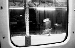 In the London Underground (YYL Photography) Tags: uk light england people blackandwhite bw white man motion black london english film blanco public underground subway person blackwhite nikon noir noiretblanc metro unitedkingdom britain 28mm negro transport el notdigital bianco blanc nero biancoenero nikkormat toosmall negroyblanco availabledarkness nikkormatel brur yylphotography
