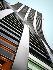 Wavy building (tanakawho) Tags: city light sky urban color building geometric glass metal wall architecture tokyo exterior searchthebest line curve shape wavy twisted debeers tanakawho 1on1architecturephotooftheweek 1on1architecturephotooftheweekoctober2008
