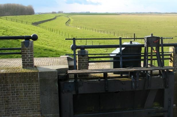 Dutch sluice and dyke at Ezumazijl, Friesland, The Netherlands
