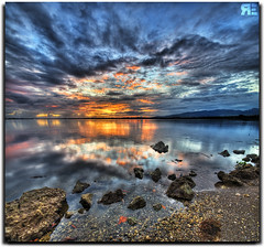 The night I set the sky on Fire... (Ryan Eng) Tags: ocean sunset sea sky seascape mountains reflection water hawaii 1 sand rocks cs2 oahu horizon tripod shoreline bluesky explore pearlharbor dri hdr highdynamicrange waterreflection verticalpanorama waterscape orangesunset pearlcity photomatix digitalblending sigma1020 7exposures frontpageexplore nikond90 vertorama ryaneng november152008 ryausting