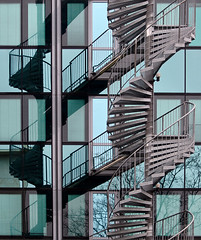 Round And Round... (Philipp Klinger Photography) Tags: windows reflection building tree glass metal architecture stairs facade germany deutschland office europa europe hessen frankfurt branches round exit railing philipp hesse klinger tourquoise aplusphoto dcdead unusualviewsperspectives