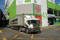 TRUCKING IN HONG KONG (Claude  BARUTEL) Tags: china port buildings harbour transport hong kong container trucks trucking scania