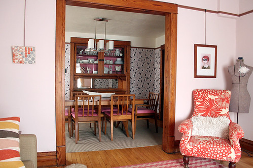 Living Room and Wallpapered Dining Room