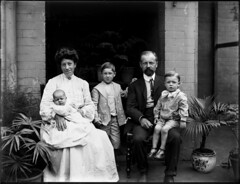 Family portrait with mother, father, two small boys and baby