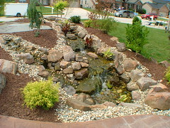 Waterfall Landscape (Altered Grounds) Tags: landscaping patio waterfalls treeline pergola patios waterfeatures outdoorkitchen outdoorfireplace landscapewaterfall doublewaterfall doublewaterfeature waterfallslandscaping