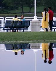colorful reflections (Five eyes) Tags: park people lake water colors rain june reflections colorful thumbsup 2008 macatawa 1055 kollen challengeyouwinner photofaceoffwinner pfogold thechallengefactory