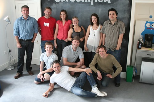The Carsonified Team posing in front of the blackboard