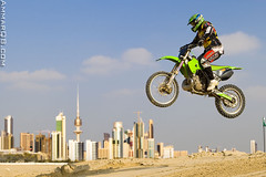 Above The City (Ammar Alothman) Tags: show sky 3 sports bike sport race canon eos fly flying flickr gulf action mark 1d kuwait ammar extremesport kuwaitcity kw q8 mark3   alothman ammaralothman 3mmar  kuwaitpictures kuwaitiphotographer kuwaitphoto kuwaitphotos ammarphotos ammarq8 ammarphoto eos1dmarkiii 1dmarkiii eos1dmark3 ammarphotography kuwaitpic kuwaitpictrue whereiskuwait bikefly canon1dmarkiii canonmarkiii canon1dmark3 canonef2470mmf28lisusm canonmark3 kuwaitvoluntaryworkcenter