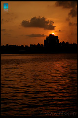 Blushing... (:: niKk clicKs ::) Tags: sunset india building clouds canon river kiss kerala cochin kochi ernakulam rainclouds southindia periyar blushing nikk blueribbonwinner godsowncountry aluva alwaye canoneoskissdigitalx queenofarabiansea picnikk