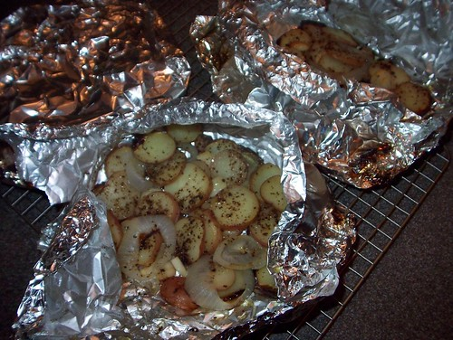 roasted potatoes and onions on grill