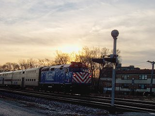 Eastbound Metra morning commuter local passing through Elmwood Park Illinois. January 2007.