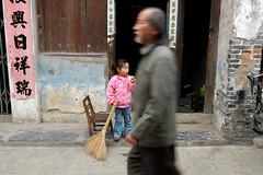Xingping Street (Marnie Recker) Tags: china street motion girl chinese broom xingping