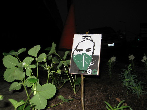 Guerilla Garden logo amongst the strawberries