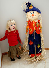 Emily and her Scarecrow (AbbieJayne) Tags: thanksgiving red portrait baby cute fall halloween girl smile wisconsin laughing kid child scarecrow adorable straw