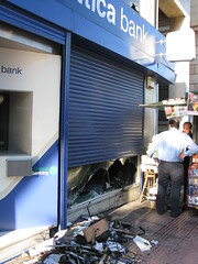 Attica Bank (Tilemahos Efthimiadis) Tags: rally hellas bank athens greece 100views damage 300views 200views riots 50views anarchists attica  panepistimiou  griots      greekriots    address:city=athens address:country=greece