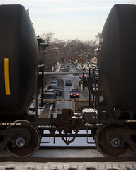 (Cycle the Ghost Round) Tags: street city railroad trees winter urban snow cars train buildings track afternoon village gbrearview rails trucks oakpark tankcars canoneos5d canonef70200mmf28lisus