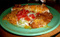 Smothered shredded beef burrito at Garcia's (Scorpions and Centaurs) Tags: food dinner tomato restaurant rice plate refriedbeans delicious mexican dining burrito garcias garnish smothered shreddedbeef