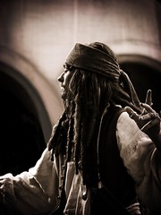 Captain Jack Sparrow #2: Still Piratey After All These Years (Kiki FL) Tags: sepia orlando florida olympus disney adventure pirate e3 wdw johnnydepp waltdisneyworld zuiko themepark mk magickingdom piratesofthecaribbean adventureland blackpearl captainjacksparrow caribbeanplaza