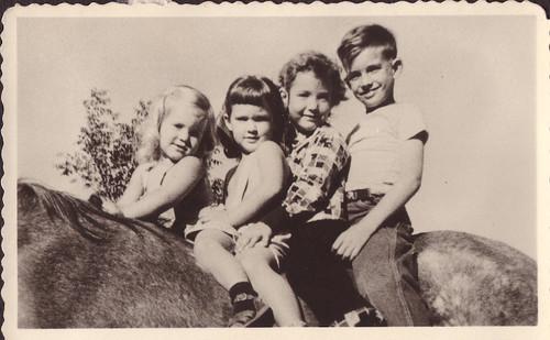 Cousins on horseback