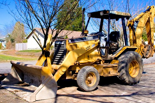 Turbo - a yellow backhoe - construction equipment in Stayton Oregon