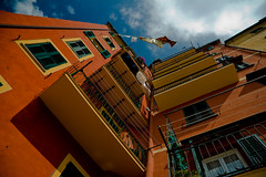 looking up (flamed) Tags: morning italy clouds colorful europe angle flat liguria wideangle lookingup countries shutters balconies cinqueterre clothesline colourful cinqueterra camogli washingline bigfave abigfave