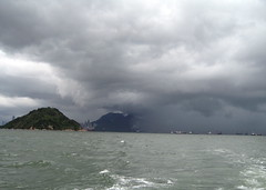 Storm Moving In Over Hong Kong (mccannmitchell) Tags: china city blue sea summer sky sunlight storm green nature water rain clouds island hongkong grey islands movement chinatown ominous threatening chinese surreal eerie tropical watercolour splishsplash hypnotising weatherwatch