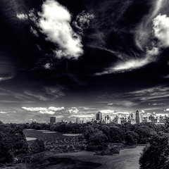 Eastern Glow ([Adam Baker]) Tags: new york city nyc summer sky bw lake building skyline clouds canon centralpark lawn hdr splittone photomatix adambaker 40d skyascanvas tokina1116 reflectyourworld