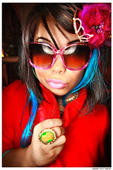 .katchME. (.SANCHEZ.) Tags: pink flowers blue red portrait woman reflection face photoshop canon glasses hands colorful panda bright sandiego princess jessica vibrant fingers style funky jewelry highlights lips pearls ring crown pedals jpg bullring ringflash sanchez accesories elcortez catchlight peirce 40d kennysanchez kennysanchezcom