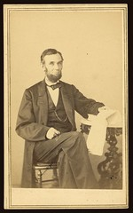 [Abraham Lincoln, U.S. President. Seated portrait, holding glasses and newspaper, Aug. 9, 1863] (LOC)