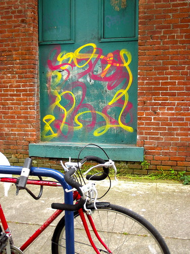 Bike, brick, stoop and paint