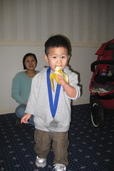 Enjoying my finishing banana and medal