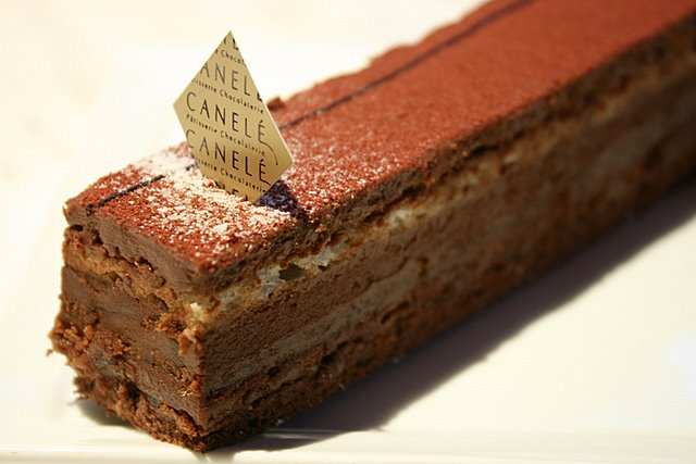 Le Royale - Chocolate mousse 66% layered with hazelnut feullitine, almond success and chocolate genoise with rum