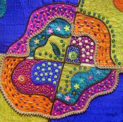 Closeup stained glass (Karen Cattoire) Tags: original art colorful handmade embroidery originalart creation fabric fiberart patchwork beading textileart tissu abstrait textiledart karencattoire fibretextile arttexilte