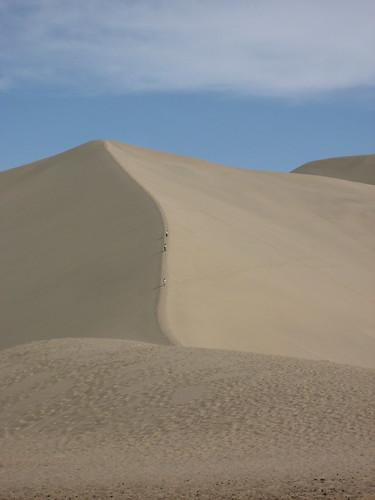 Someone climbing the dune