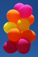 Brightly Richly Dazzling (Jadydangel) Tags: pink blue sky orange sunlight yellow balloons bright vivid multicolor oohshiny cmwdorange notexplored jadydangel