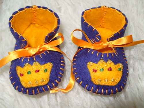 ROYAL BLUE AND GOLD HANDMADE BABY BOOTIES WITH CROWN MOTIFS by Funky Shapes
