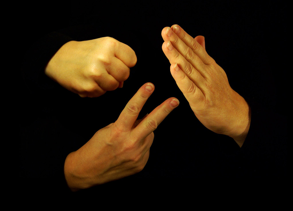 rochambeau rock paper scissors 2) phonetic french for rock-paper-scissors (the 3 friends roshamboed for the bill after wolfing down a humongous lunch at the local diner (the 3 friends roshamboed for the bill after wolfing down a humongous lunch at the local diner.