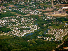 Chicago suburbs from the air (Scorpions and Centaurs) Tags: travel houses vacation holiday chicago streets airplane flying suburban flight over lakes aerial suburbs roads neighbourhood fromtheair subdivision