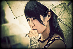 Smoking girl (manganite) Tags: girls portrait people cute topf25 colors beauty face rain fashion japan digital umbrella dark hair geotagged asian japanese tokyo costume cool xpro topf50 nikon colorful asia cosplay tl framed cigarette candid gothic young teens style smoking rainy harajuku fancy teenager  nippon  d200 nikkor dslr gals umbrellas vignette nihon kanto stylish japanesegirl  18200mmf3556 utatafeature manganite nikonstunninggallery date:year=2006 date:month=september date:day=17 geo:lat=35669843 geo:lon=139702238 format:ratio=32