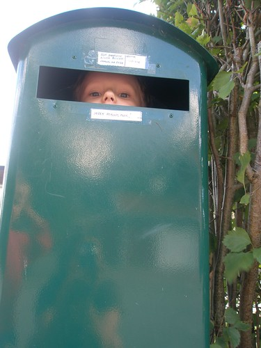 mailbox with a child inside, peeking out