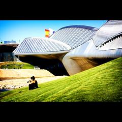 In The City of No Limits (tochis) Tags: bridge blue summer sky black hot green grass architecture river spain warm europe photographer sunny pop clothes zaragoza aragon es ebro vignette slope zahahadid almozara expo2008 expozaragoza2008 flickraward platinumheartaward colourvisions bridgepavillion
